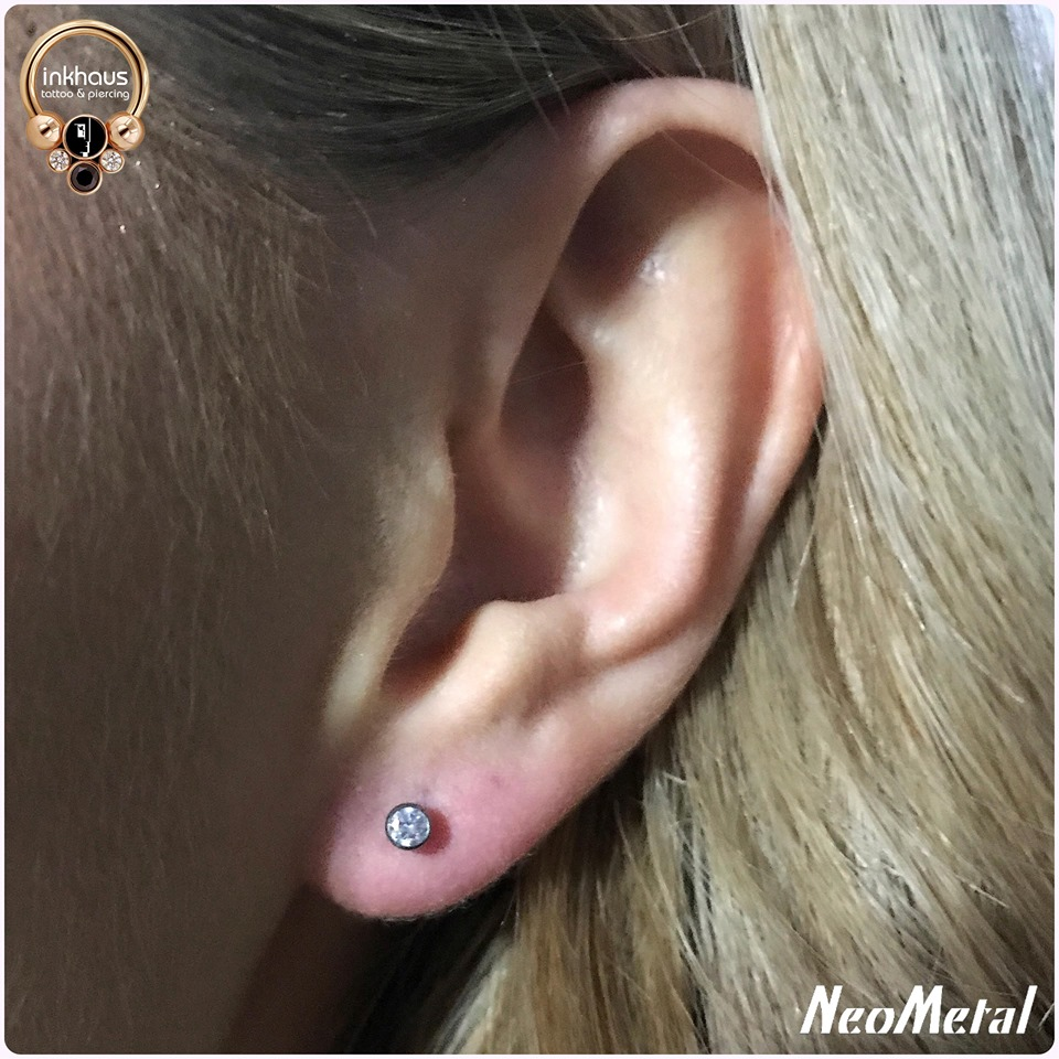 Ear lobe with NeoMetal. Inkhaus Tattoo.