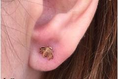 Ear lobe with LeRoi. Inkhaus Tattoo.