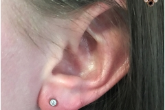 Ear lobe with NeoMetal. Inkhaus Tattoo.