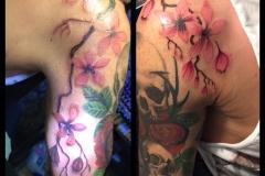 Cherry Blossom around Skull and Roses. Inkhaus Tattoo.