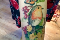Healed Robin with Butterflies and Flowers. Inkhaus Tattoo.
