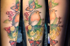 Robin with Butterflies and Flowers. Inkhaus Tattoo.