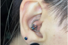 HEALED daith with Anatometal CBR with black and red opal cluster. Inkhaus Tattoo.