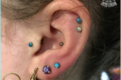 Second Ear Lobes with Industrial Strength Opals. Inkhaus Tattoo.