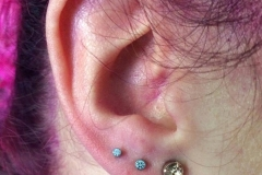 Second and Third Ear Piercings with NeoMetal. Inkhaus Tattoo