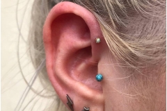 Forward Helix w/ 18k prong set rose gold opal from Anatometal. Inkhaus Tattoo.