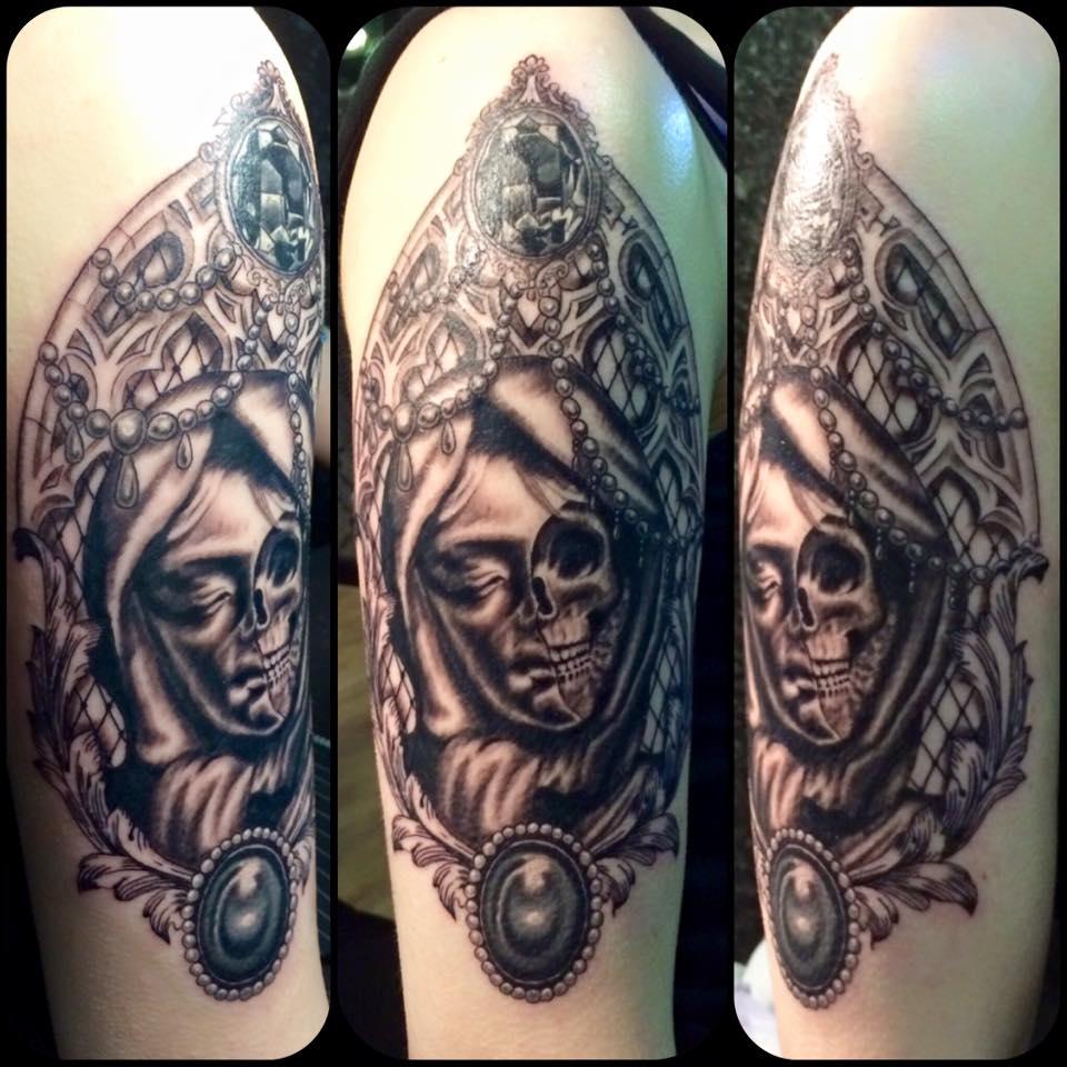Memento Mori upper arm in greyscale.