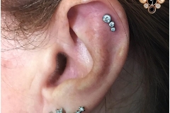Helix Piercing with Anatometal Gem Cluster. Inkhaus Tattoo.