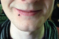 Side Labret. Inkhaus Tattoo.