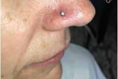 Nose piercing w/ 2.5mm NeoMetal white opal. Inkhaus Tattoo.