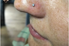 Nose piercing with 2mm NeoMetal white opal. Inkhaus Tattoo.