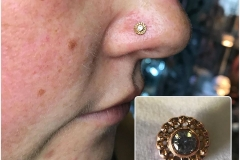 Healed nose piercing with Anatometal Gold. Inkhaus Tattoo.