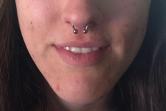 Septum Piercing with Circular Barbell. Inkhaus Tattoo.