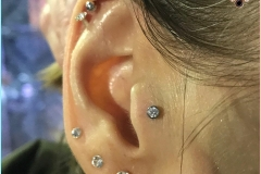 Tragus Piercing with NeoMetal. Inkhaus Tattoo.